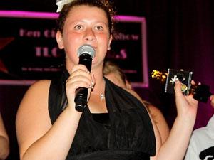 Ariel receiving her award at the TLC talent show